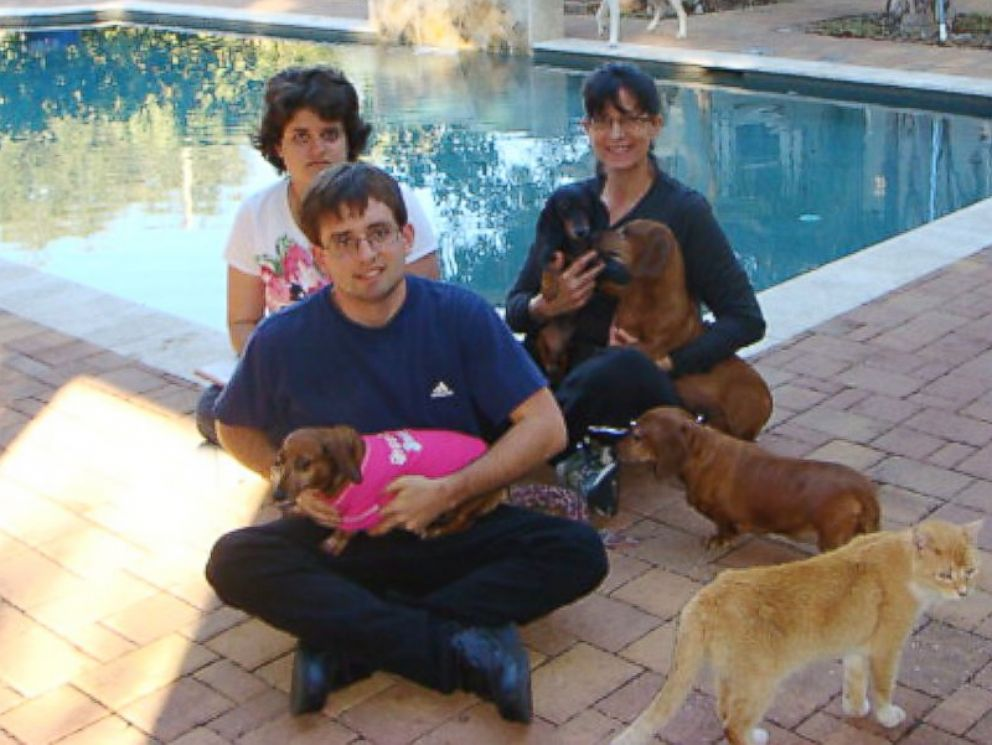 PHOTO: Sandy Lewers, right, on Sunday adopted a disabled dachshund that has comforted her autistic children, Kevin, 21, and Lia, 18, in Tampa, Fla.