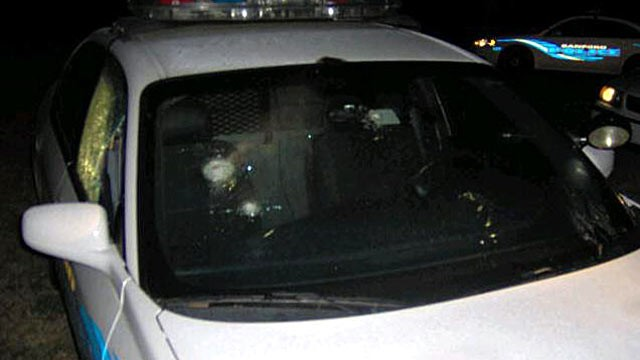 PHOTO: A Sanford Police vehicle was shot several times while it was parked in the parking lot of Bentley Elementary School as a visible deterrent in Sanford, Fl.