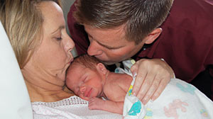 PHOTO: Shown here is Carolyn and Sean Savage with their baby.