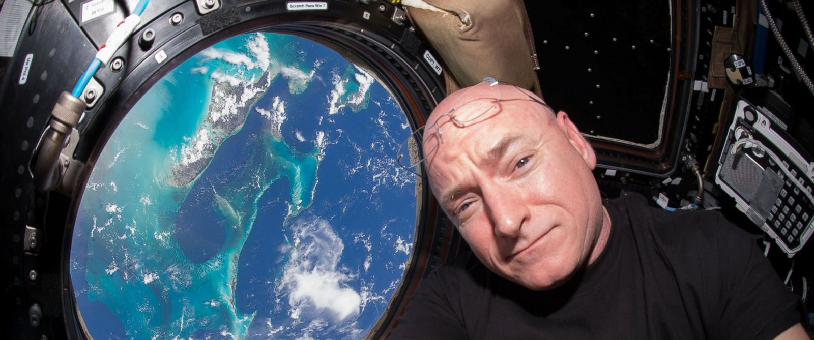 PHOTO: Expedition 44 flight engineer and NASA astronaut Scott Kelly seen inside the Cupola, a special module which provides a 360-degree viewing of the Earth and the International Space Station.