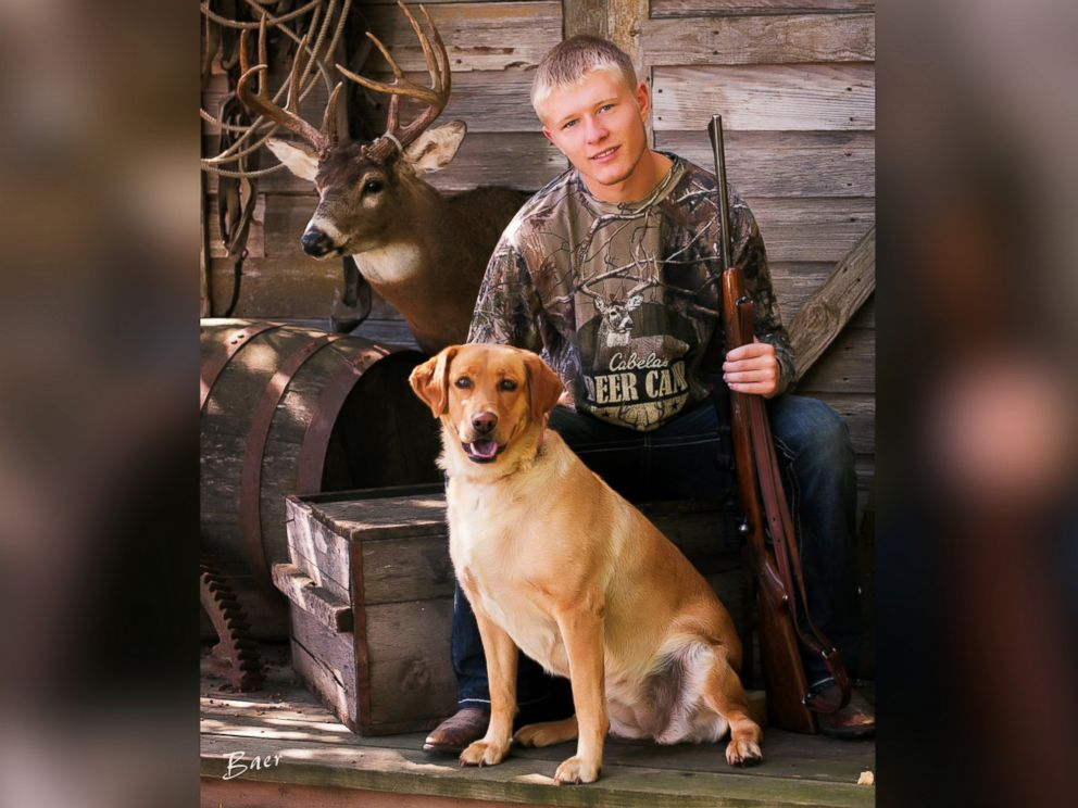 PHOTO: Nebraska senior Christian Burr poses with his dog, trophy mount and a rifle given to him by his grandfather.