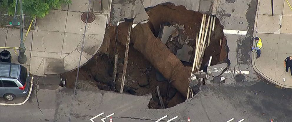 PHOTO: Officials say the sinkhole formed due to a water leak under the road.