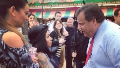 PHOTO: Snooki speaks with New Jersey Governor Chris Christie on May 24, 2013.