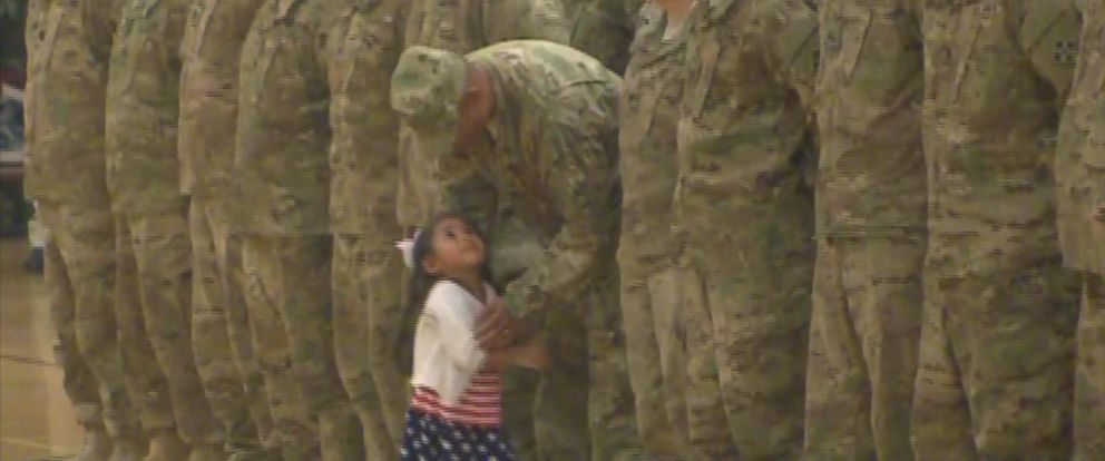 PHOTO: Daniel Oglesbys young daughter ran up to him in the middle of his homecoming ceremony in Fort Carson, Colo.