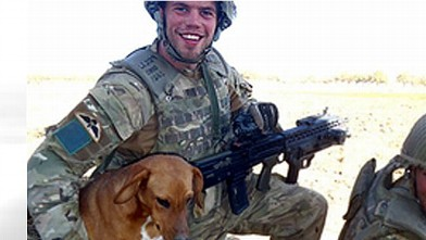 PHOTO:Pte. Conrad Lewis from the 4th Battalion, Parachute Regiment, is shown with his dog, Pegasus.
