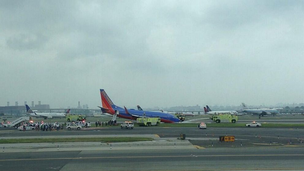 PHOTO: The nose gear of a Southwest plane landing at New York's LaGuardia Airport collapsed as the aircraft landed on the runway on July 22, 2013.