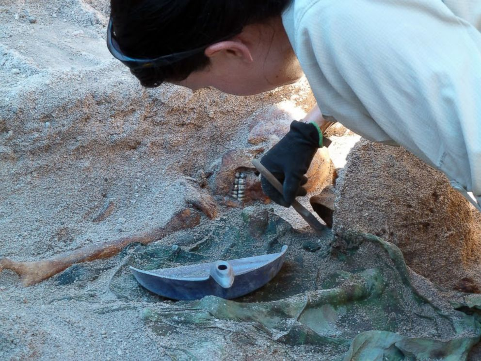 PHOTO: Lead archaeologist Kristen N. Baker of History Flight, Inc., carefully exposes the remains of Medal of Honor recipient, First Lt. Alexander Bonnyman, Jr. Betio, Tarawa Atoll, Republic of Kiribati. May 28, 2015.