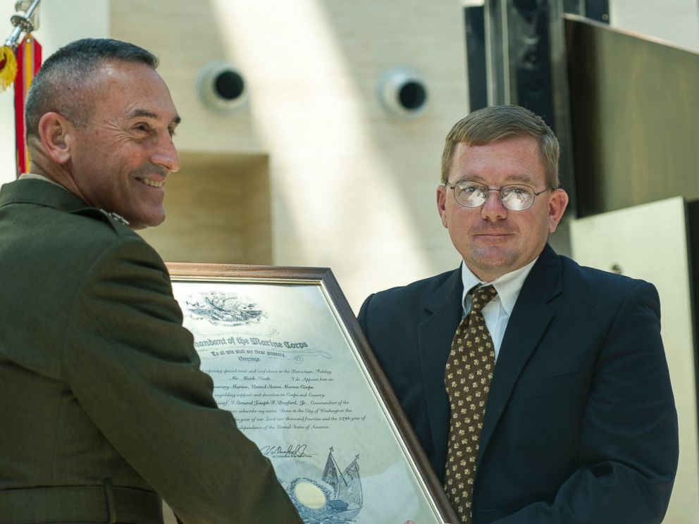 PHOTO: U.S. Marine Corps Maj. Gen. James Lukeman presents Mark Noah of History Flight, Inc. with the title of Honorary Marine during a ceremony held at the National Museum of the Marine Corps, Triangle, Va., July 24, 2015.
