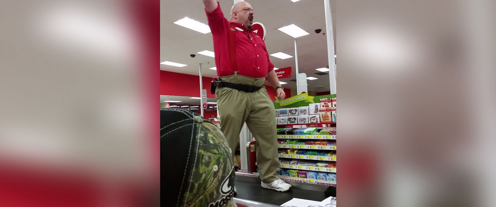 PHOTO: Target employee Scott Simms gives coworkers a pep talk before the Black Friday rush.