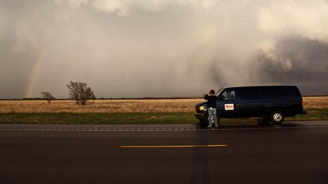 PHOTO: A member of a tornado tour steps outside the van to capture the storm, April, 2009.