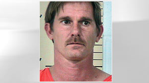 PHOTO Travis Marburger, 36, shown in this bookin photo, was arrested and charged with Manslaughter, Dec. 7, 2010. Marburger?s 10 acres will be the focus of an excavation.