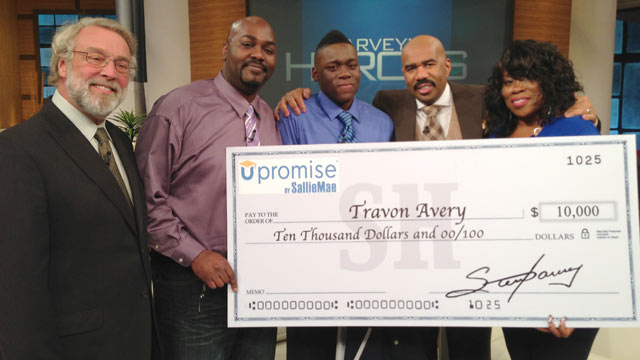 "PHOTO: Travon Avery, center, was awarded $10,000 on the ""Steve Harvey"" show as a result of saving two peoples lives in a week at his middle"