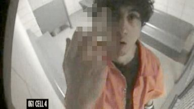 PHOTO: In an image released in court, Boston Marathon bomber Dzhokhar Tsarnaev makes an obscene gesture at the camera while in a cell in July 2013.