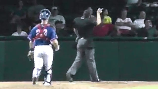 PHOTO: Minor League Baseball umpire Mario Seneca ejected Daytona Cubs intern Derek Dye for playing 'Three Blind Mice', Aug. 1, 2012.