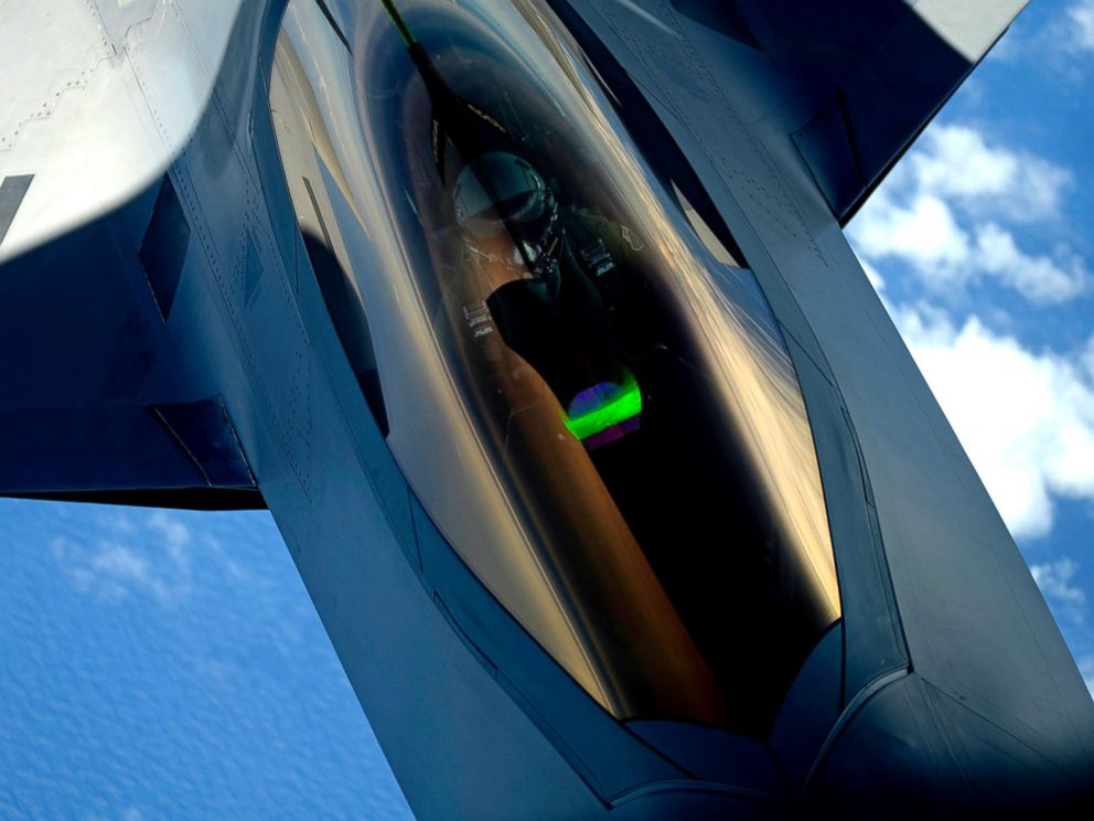 PHOTO: A U.S. Air Force F-22 Raptor aircraft with the 1st Fighter Wing receives a midair refueling from a KC-135 Stratotanker aircraft assigned to the 756th Air Refueling Wing over Joint Base Andrews in Maryland July 10, 2012.