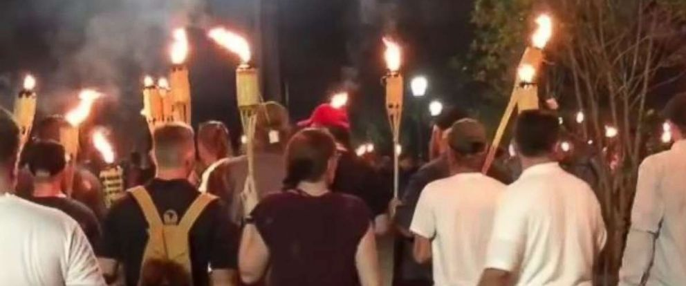 PHOTO: White nationalists carrying tiki torches march on the Charlottesville campus of the University of Virginia.