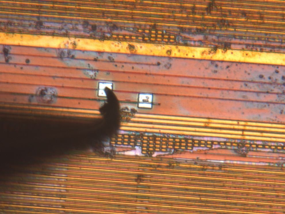 PHOTO: A probe lands on a pad on the microchip. The pads, the small white squares, are approximately half the width of a human hair.