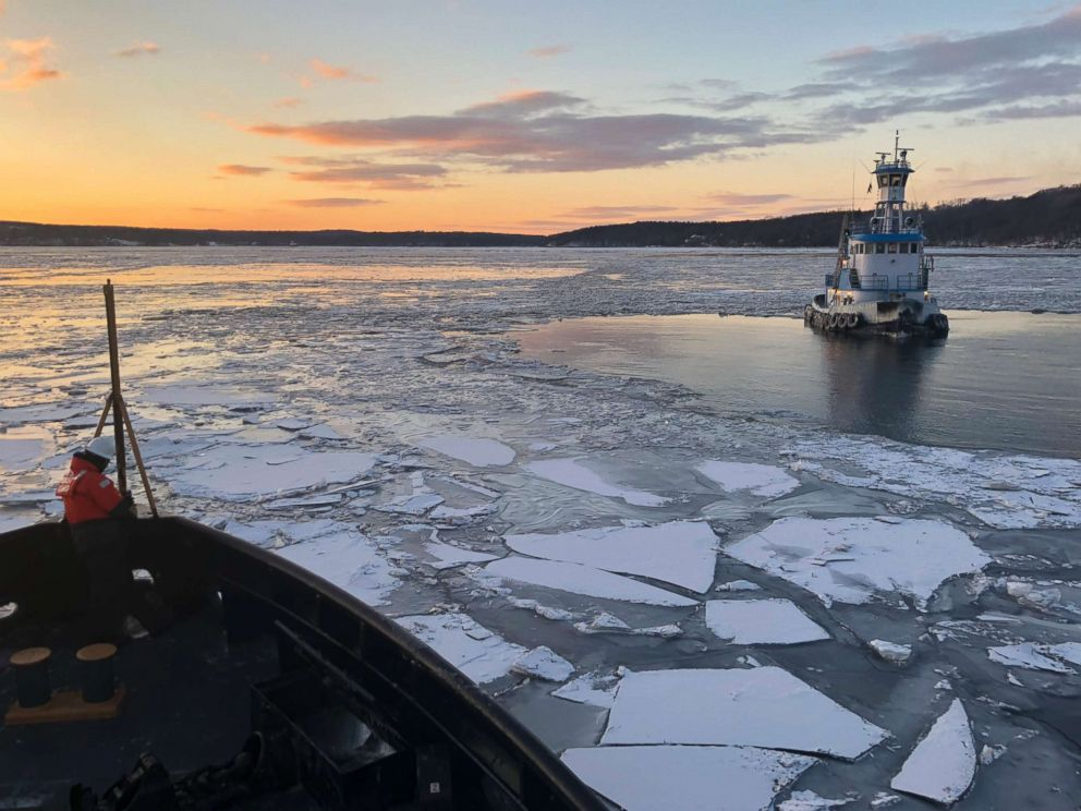 PHOTO: Coast Guard Cutter Penobscot Bay helps break free commercial tug Stephanie Dann from the ice on the Hudson River near Kingston, N.Y., Jan. 2, 2018.