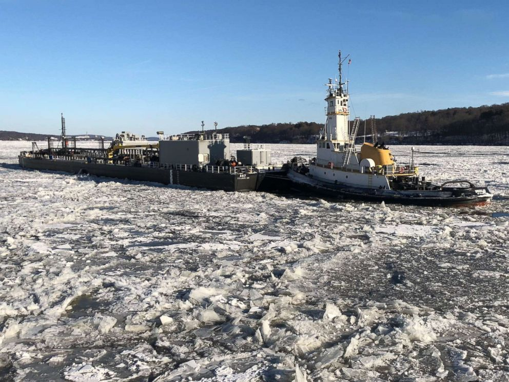PHOTO: Coast Guard Cutter Penobscot Bay helps break free commercial tug Brooklyn from the ice on the Hudson River near Saugerties, N.Y., Dec. 31 2017.