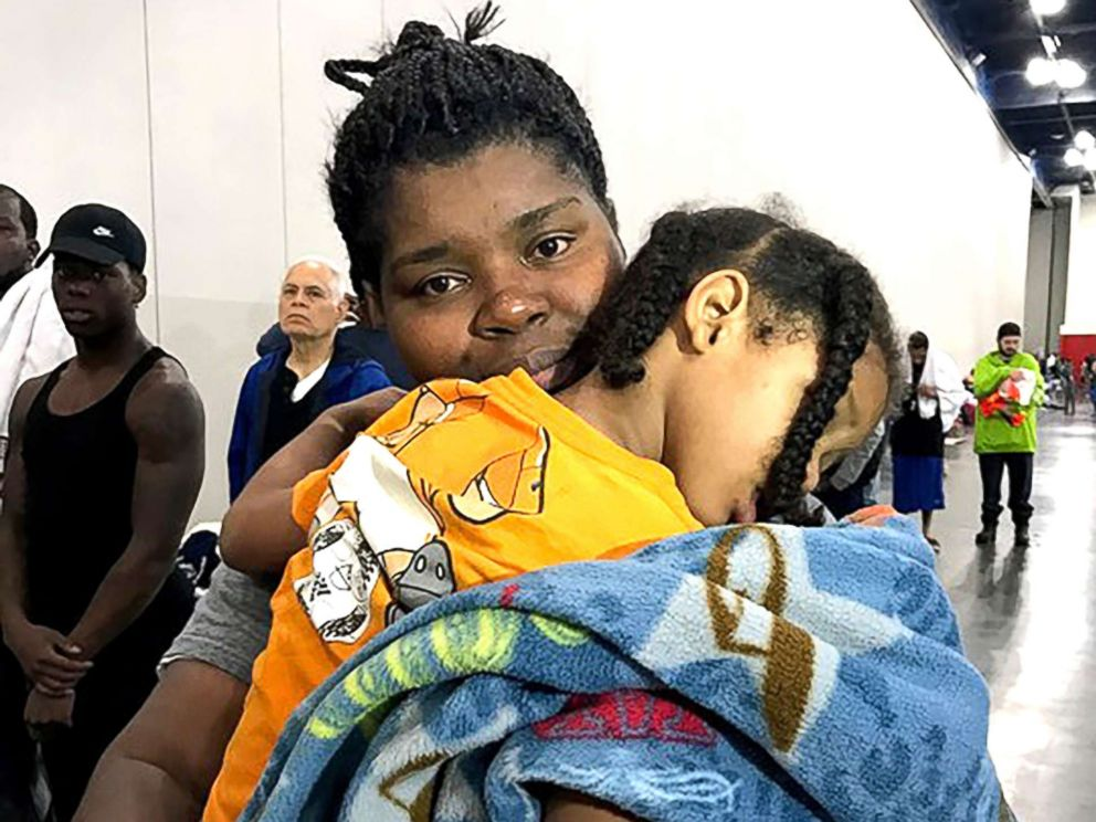 PHOTO: Iashia Nelson embraces her son after they were rescued from the rooftop of a downtown Houston apartment building where they were stranded following Hurricane Harvey.