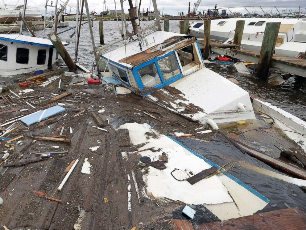 PHOTO: Boats that sunk in the wake of Hurricane Harvey are surrounded by floating debris, Aug. 27, 2017, in Rockport, Tx.