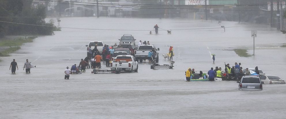 PHOTO: Residents wait to be rescued from the flood waters of Tropical Storm Harvey in Beaumont Place, Texas, Aug. 28, 2017.