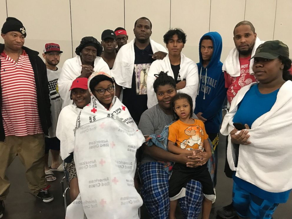 PHOTO: Iashia Nelson and her son are photographed here with other storm victims in Houston