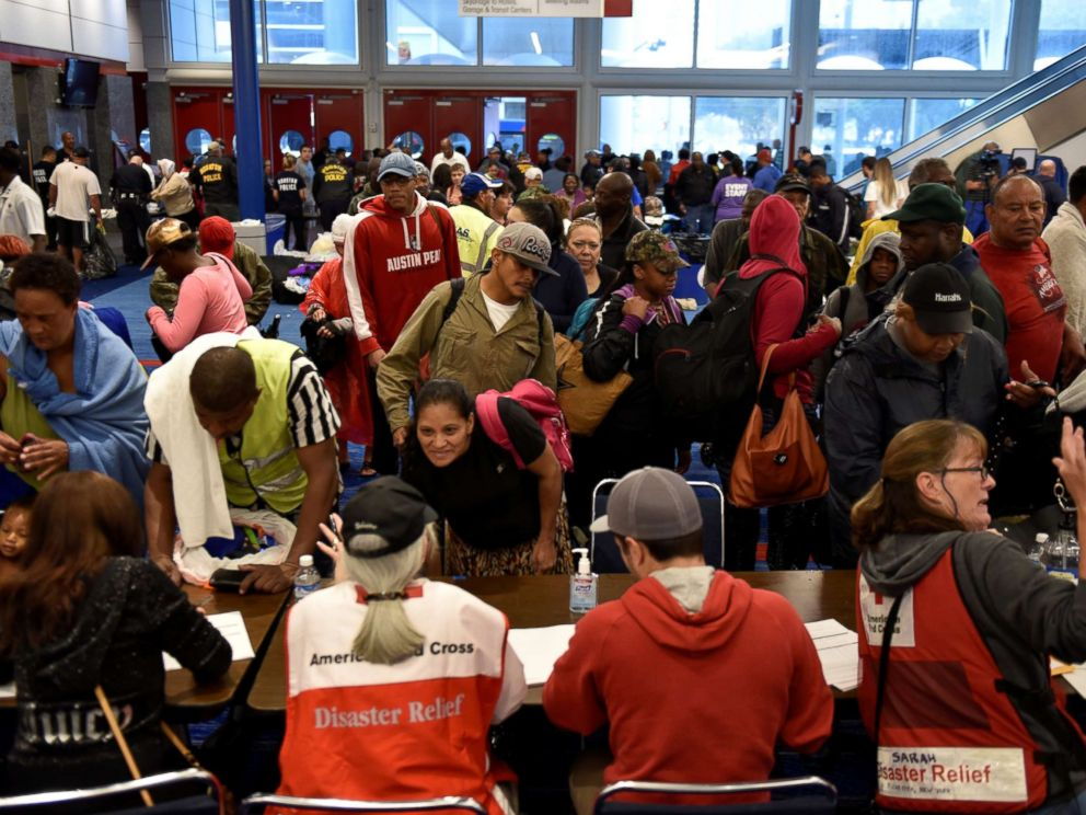 PHOTO: Volunteers with The American Red Cross register evacuees at the George R. Brown Convention Center after Hurricane Harvey inundated the Texas Gulf coast with rain causing widespread flooding, in Houston, Aug. 28, 2017.