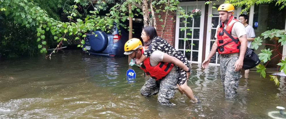 PHOTO: Texas National Guard soldiers aid stranded residents in heavily flooded areas from the storms