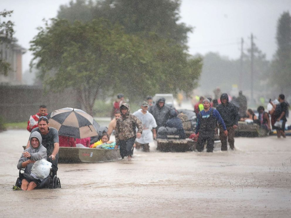 PHOTO: People are rescued from a flooded neighborhood after it was inundated with rain water, remnants of Hurricane Harvey, Aug. 28, 2017, in Houston.