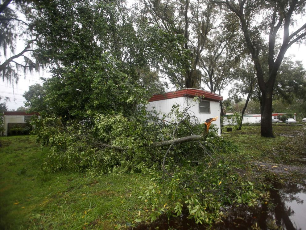 PHOTO: A fallen branch lays beside a mobile home after Hurricane Irma made landfall in Tampa, Fla., Sept. 11, 2017.