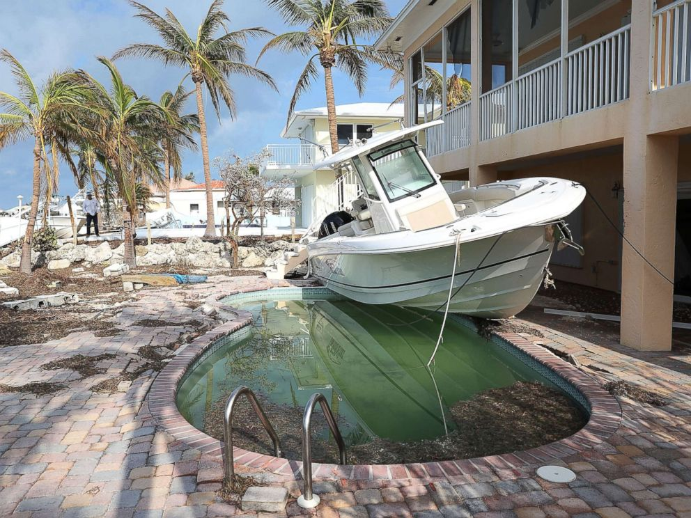 PHOTO: A boat is seen next to a home after Hurricane Irma passed through the area, Sept. 13, 2017, in Duck Key, Florida.