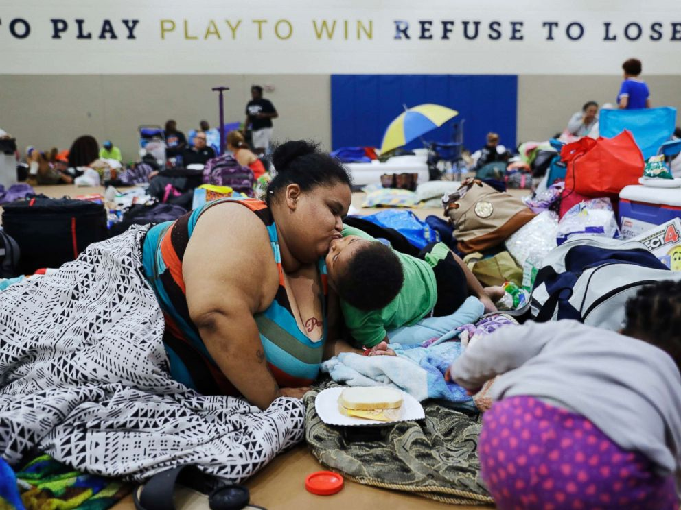 PHOTO: Annette Davis kisses her son Darius, 3, while staying at a shelter in Miami after evacuating from their home in Florida City, Fla., ahead of Hurricane Irma, Sept. 9, 2017.