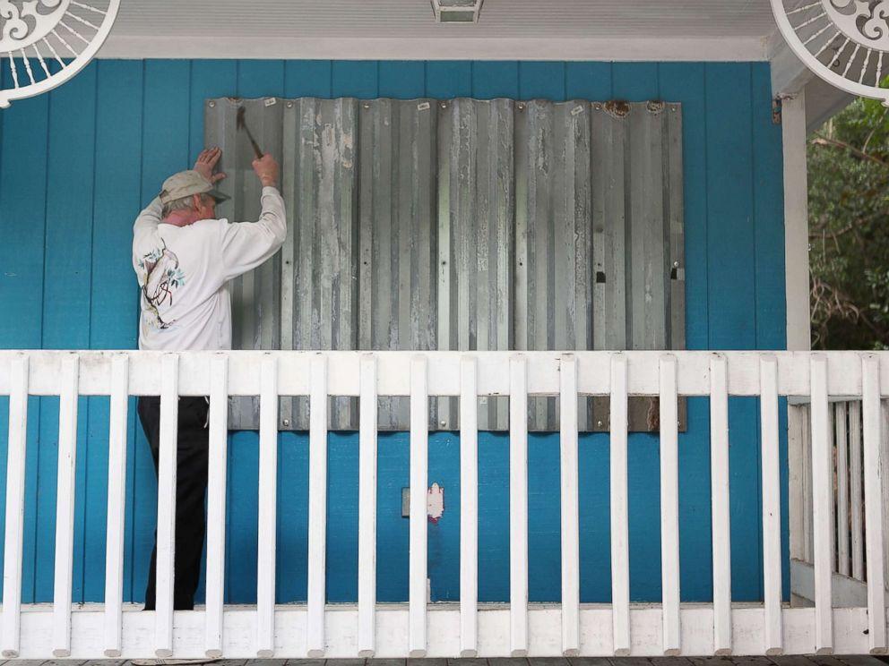 PHOTO: Mark Waddell installs hurricane shutters to a house in the Florida Keys, Sept. 6, 2017, in Islamorada, Fla.