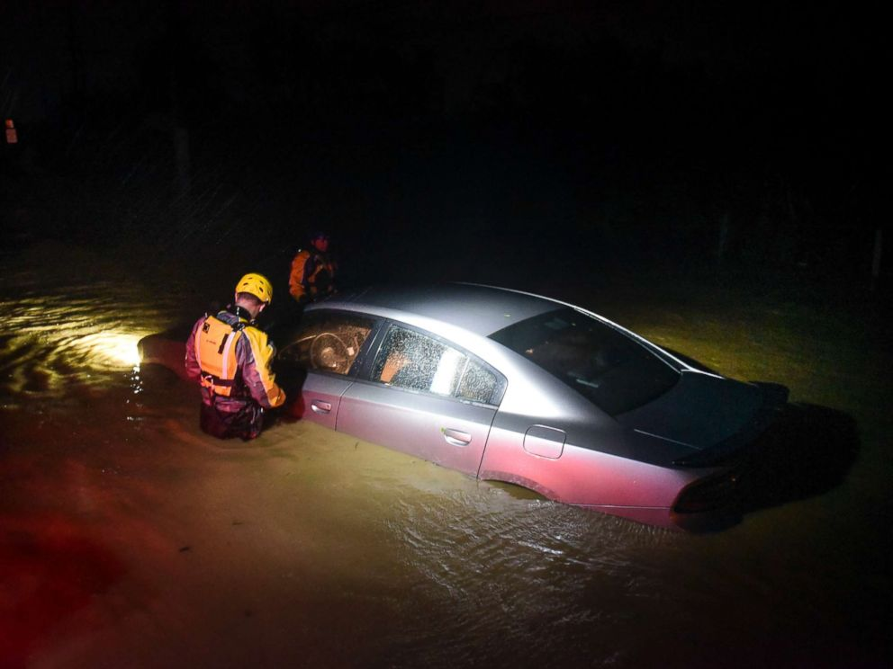 PHOTO: Rescue staff from the Municipal Emergency Management Agency investigate an empty flooded car during the passage of Hurricane Irma through the northeastern part of the island in Fajardo, Puerto Rico, Sept. 6, 2017.
