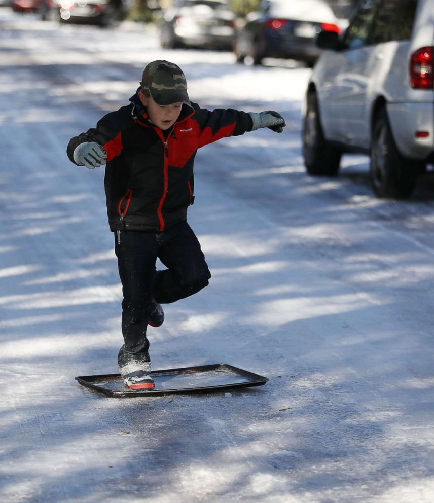 PHOTO: Shebuel Fenster slides along an ice covered street in Savannah, Georgia, Jan. 4, 2018.