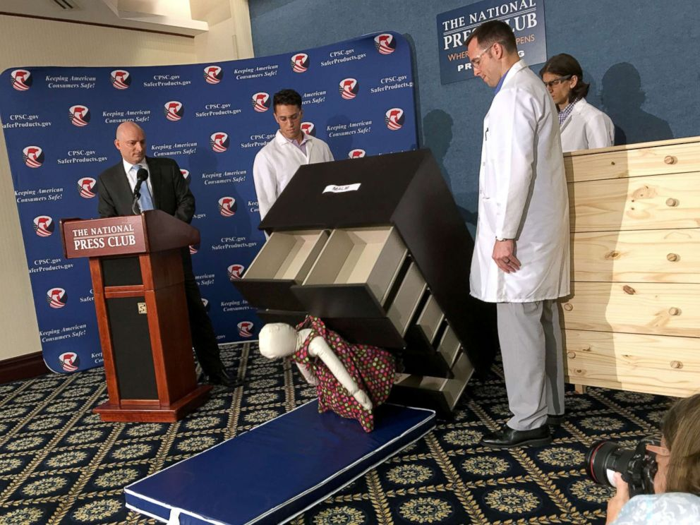 PHOTO: Consumer Product Safety Commission employees watch as a 28-pound dummy falls beneath IKEAs Malm model chest of drawers, during a live demonstration at the National Press Club in Washington, June 28, 2016.