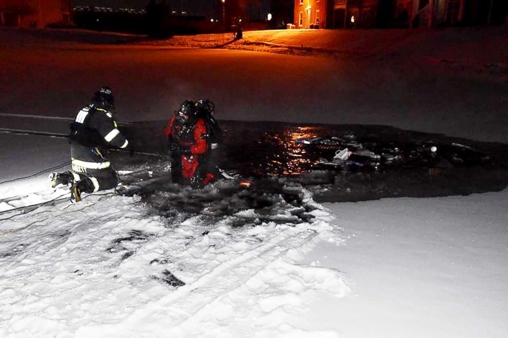 PHOTO: Fire crews raced to rescue a woman from her submerged car after she drove into an icy pond at an apartment complex in Indianapolis, Ind.