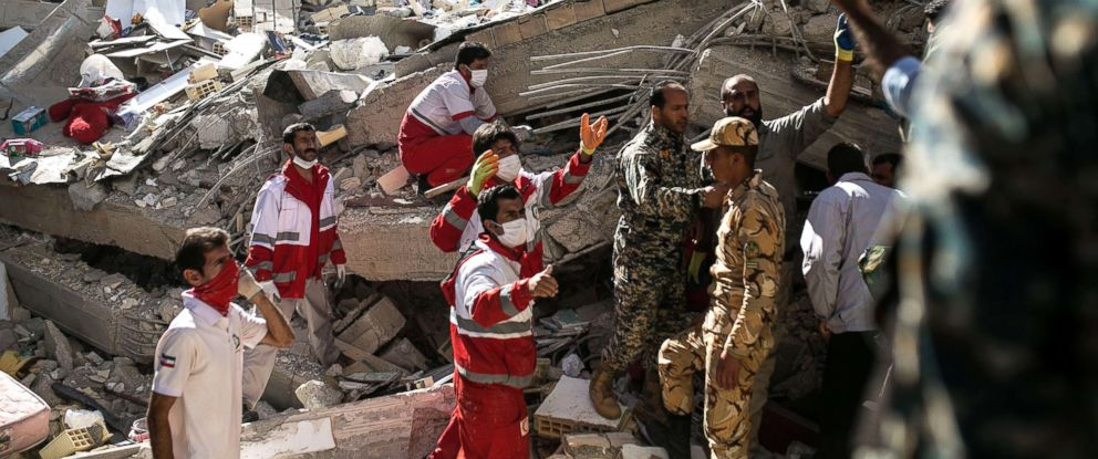 PHOTO: Rescuers search for survivors in front of damaged buildings in Sarpol-e Zahab, Iran, Nov. 13, 2017.