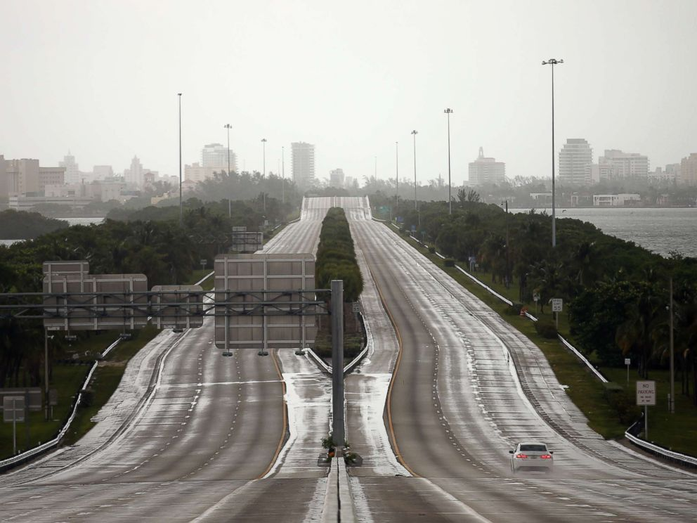 PHOTO: A car drives along an empty highway in Miami before the arrival of Hurricane Irma to south Florida, Sept. 9, 2017.