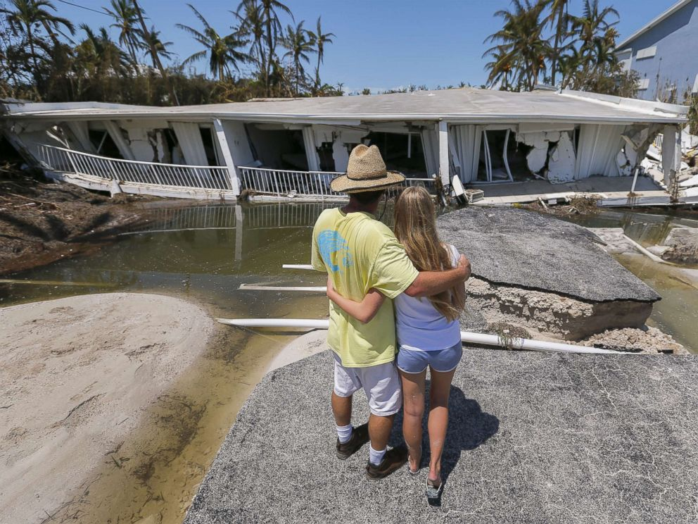 PHOTO: Mike Gilbert hugs his daughter Brooke while looking at a destroyed three-story condominium building after Hurricane Irma struck the Florida Keys in Islamorada, Fla., Sept. 12, 2017. The Gilbert family owns a unit in the building.
