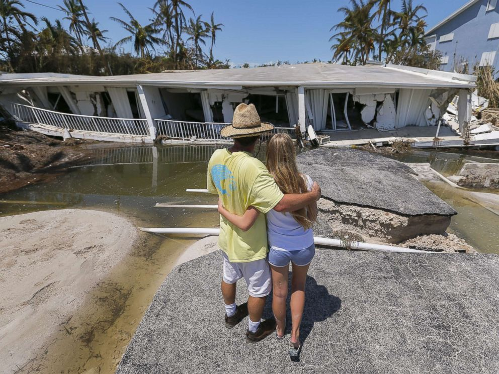 PHOTO: Mike Gilbert hugs his daughter Brooke while looking at a destroyed three-story condominium building after Hurricane Irma struck the Florida Keys in Islamorada, Fla., Sept. 12, 2017.