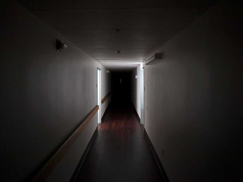 PHOTO: A darkened hallway is pictured at Cypress Run assisted living facility, after Hurricane Irma caused the power outage in the building in Immokalee, Fla. Sept. 12, 2017.