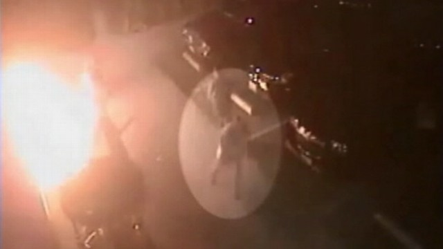 VIDEO: Police search for suspect who threw a bottle of flammable liquid at a man outside a Long Beach store.
