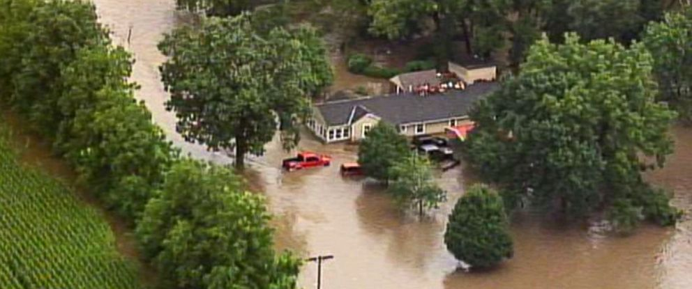 PHOTO: This aerial photo from a video by KCTV5 shows a family forced onto the roof of a home in Overland Park, Kan., Aug. 22, 2017, after heavy rains caused flash flooding in the Kansas City area. Flash flood warnings have been issued across the area.