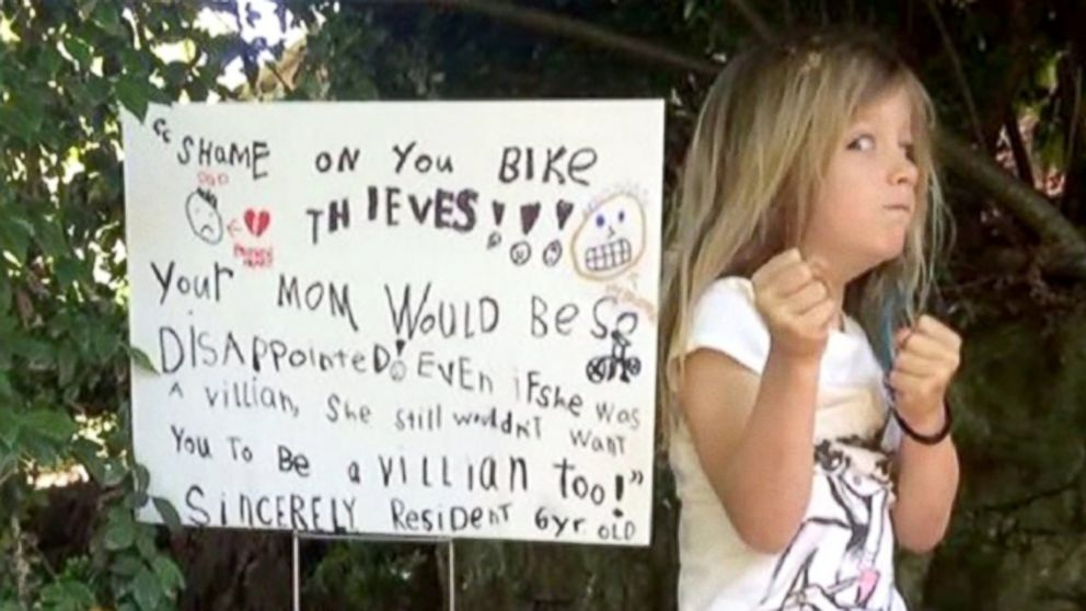 PHOTO: Six-year old Roxy from Portland, Ore. poses with the sign that she made after thieves broke into her familys garage and stole her fathers bikes.