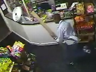 Watch: Armed Robber Chased Off With Stick