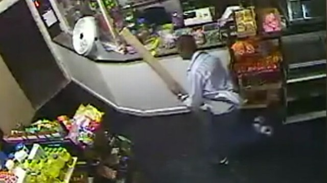 VIDEO: Seattle store owner used a piece of wood to scare off a gun-wielding robber.