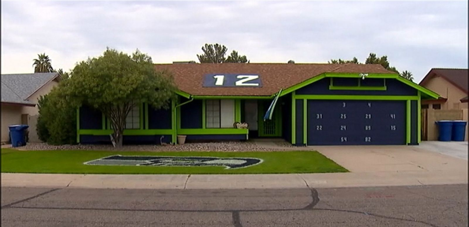 VIDEO: Ashtin Fitzwater painted his Arizona home in the Seahawks' blue and green and put the team logo on his front lawn.