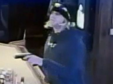 PHOTO: An image made from video released by police in Puyallap, Wash. shows a man who robbed a bartender at gunpoint after ordering and paying for two shots of liquor on Aug. 31, 2015.